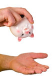 Hand hold an empty piggy bank Royalty Free Stock Images