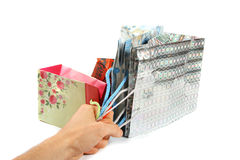 Hand hold four gift bags Royalty Free Stock Photography