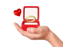 Hand hold a gift box with wedding ring Stock Photo