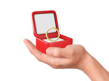 Hand hold a gift box with wedding ring Stock Images