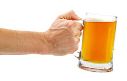 Hand hold glass mug of beer isolated on white Stock Photography