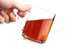 The hand hold a glass with is tea Stock Photos