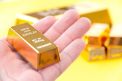 Hand hold gold bars Stock Photos