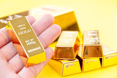 Hand hold gold bars Royalty Free Stock Image