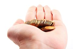Hand hold gold coins.  Isolated Royalty Free Stock Photos
