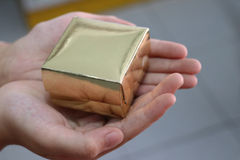 Hand hold gold square box. Hand carry gold square box Royalty Free Stock Photography