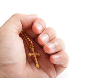 Hand hold golden cross necklace. Hand hold with golden cross necklace isolated on white background stock image