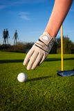 Hand hold golf ball Stock Photo