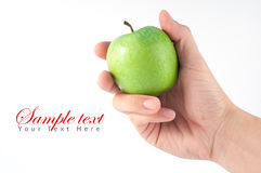 Hand hold green apple isolate Royalty Free Stock Photos