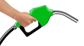 Hand hold green fuel nozzle on a white Royalty Free Stock Image