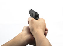 Hand hold gun firing Stock Photos