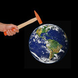Hand hold a hammer hit the world .Elements of this image furnish Stock Image
