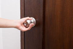Hand hold handle of wood door Stock Photo