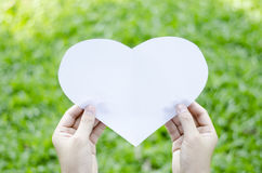 Hand hold heart paper Stock Images