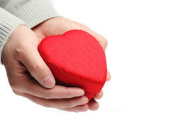 Hand hold heart shaped gift box Royalty Free Stock Photography