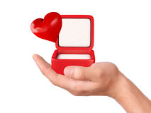 Hand hold hearts in a gift box on white background Stock Photo