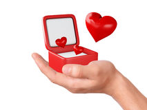 Hand hold hearts in a gift box on white background Royalty Free Stock Photos