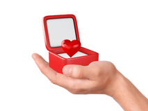Hand hold hearts in a gift box on white background Stock Photography