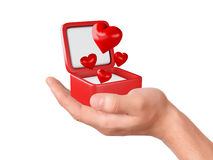 Hand hold hearts in a gift box on white background Stock Images
