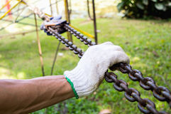 A hand hold Hook hanging. In garden Royalty Free Stock Images
