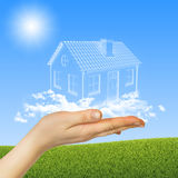 Hand hold house of clouds in the sky Stock Image