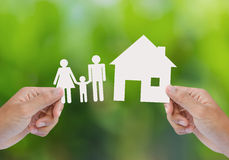 Hand hold house and family Stock Images