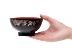 Hand hold japanese soup bowl. Isolated on white background Stock Photos