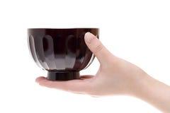 Hand hold japanese soup bowl. Isolated on white background Stock Photo