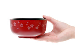 Hand hold japanese soup bowl. Isolated on white background Royalty Free Stock Photos