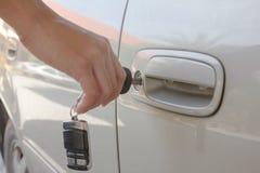Hand hold key unlock car Royalty Free Stock Photo