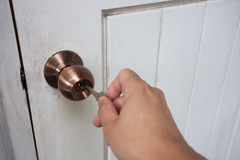 Hand hold keys to locking or unlocking the door Stock Photo