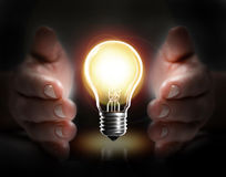 Hand hold light bulb. Means protect idea Royalty Free Stock Photos