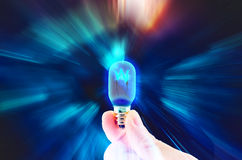 Hand hold light bulb on motion zoom lighting,technology idea Royalty Free Stock Image
