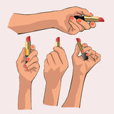 Hand hold lipstick. The hand holding a lipstick Royalty Free Stock Photo