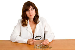 Hand hold magnifying glass and coins Stock Photos