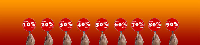 Hand hold magnifying glass focus on Discount Sale Symbols Set Stock Images
