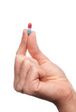 Hand hold medical painkiller pill capsule Stock Photography