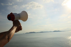 Hand hold megaphone Royalty Free Stock Images