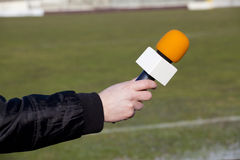 Hand hold microphone for interview Stock Photo