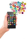 Hand hold Mobile phone with colorful application icons Stock Images
