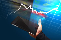 Hand Hold mobile Phone with graph stock exchange Stock Photography