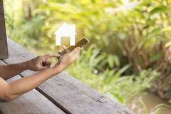 Hand hold mobile phone with home icon. business concept Stock Image