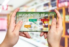 Hand hold mobile phone and using augmented reality AR app fo. R see promotion sale in supermarket store,Digital lifestyle Technology concept royalty free stock images