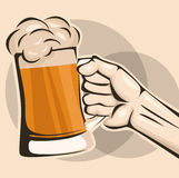 Hand hold a mug of beer Stock Image