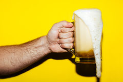 Hand hold mug of beer royalty free stock photography