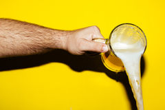 Hand hold mug of beer Stock Images