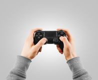 Hand hold new joystick . Gamer play game with gamepad co Stock Photos