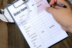 Hand hold order form. Royalty Free Stock Image