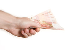 Hand hold out russian money Royalty Free Stock Images