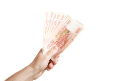 Hand hold out russian money Stock Image